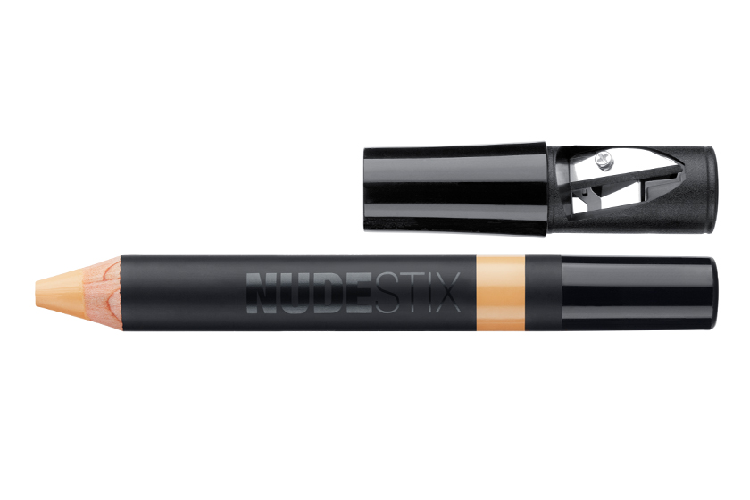 "Nudestix Skin Concealer Pencil, $28.  ""It's matte and really creamy. I have melasma on my cheeks, so that's where I use it like a spot foundation—just stripe it and blend."""