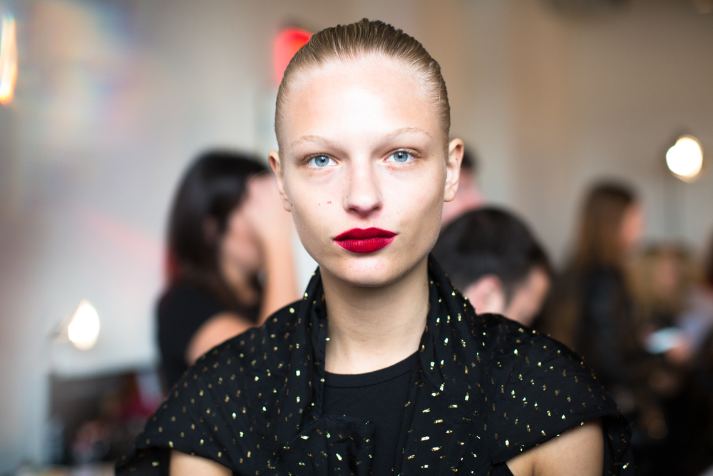 "JASON WU (Photo: Maybelline):  Yadim created what he dubbed ""Wu Red"" by custom-blending the upcoming Maybelline Color Sensational Vivid Matte Liquid in Rebel Red with a hint of Berry Boost."