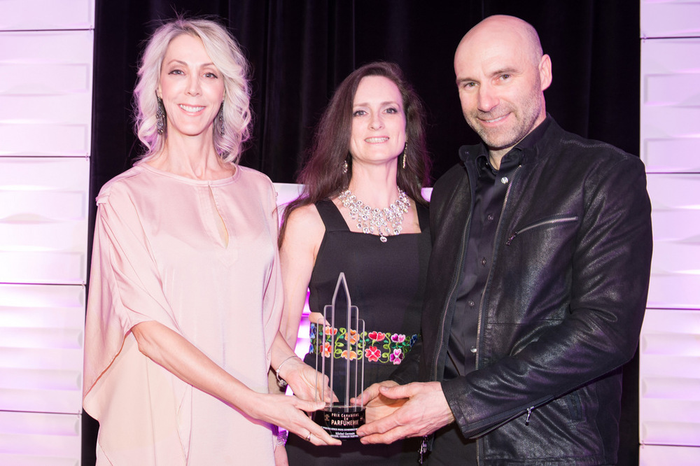 FROM RIGHT: Michel Germain WITH HIS WIFE, NORMA, RECEIVING HIS AWARD FROM COSMETICS PUBLISHER ALISON WOOD (PHOTO: RYAN EMBERLEY)