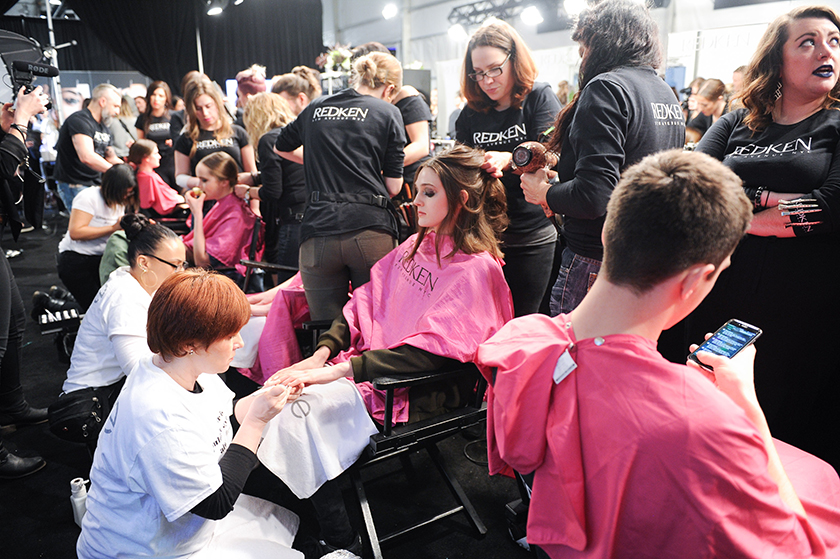 Redken and Essie artists work backstage at Montreal label Mackage's Fall 2016 Toronto Fashion Week presentation