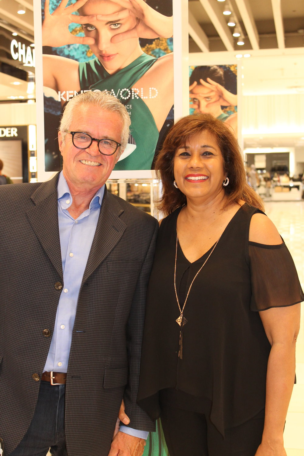 Jim Hicks with previous COSA winner Seeta Samaroo, Givenchy/Kenzo selling specialist at Hudson's Bay Sherway Gardens.