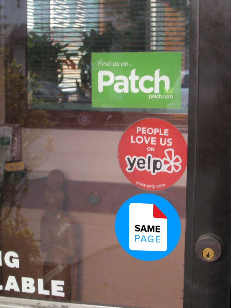sticker on door of business.jpg