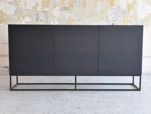 Kupa Console $2,400.00   The minimalist aesthetic of this collection champions clean lines and stylish functionality.  All pieces are Victorian Ash stained matte black, on top of powder-coated black steel frames.