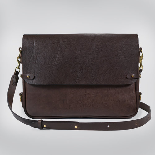 "Horizontal Satchel - $595.00   Avalible in - Chocolate and Black  Locally designed and made leather satchel. The flap and strap are made from an oily Italian vegetable tanned bovine leather that has prominent deep creases visible on the surface. The body is made from a dry milled vegetable tanned bovine leather, created by artisan tanners in Tuscany. The satchel is fully lined with a natural cream coloured light weight canvas in 100% cotton. There is a fabric laptop sleeve that fits a laptop up to a MacBook pro 15"". There is a separate front leather pocket for a charger or small accessories with another smaller fabric phone pocket that fits a large format phone. Quality craftsmanship, made with care and attention to detail. The Satchel is hand crafted in Melbourne by Japanese trained leather artist, Sarah.   DIMENSIONS: 42cm x 7cm x 32cm (LWH)  STRAP 2.5cm (W)"