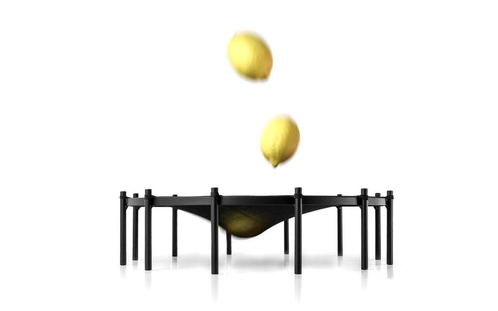 Trampoline - $198.00   Fruit Bowl; Inspired by circus artistes the trampoline fruit bowl hugs your fruit in an elastic mesh avoiding pressure marks and leaving it to breath to keep it fresh for longer.   Dimensions  - W 400mm x H 100mm   Materials   Pedestal - Black Powder Coated Steel  Netting - Black Stretch Fabric Mesh