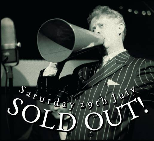The July Gin Mill Social sold out. Greg Poppleton sing through a real 1920s megaphone