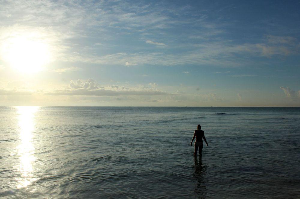 Baignade au lever du soleil, Playa del Carmen, Quintana Roo, Mexico