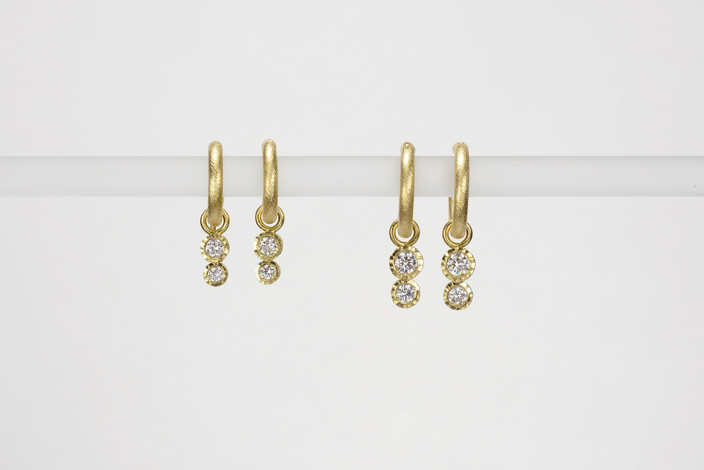 double diamond drops . 18ky gold   small - .16 ct tw gh.vs - 850.00  medium .28 ct tw gh.vs - 1350.00
