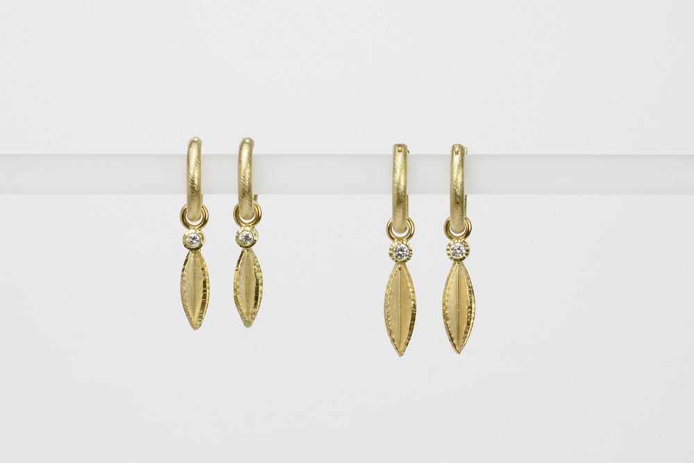 seeds with diamonds . 18ky gold   small .04 ct tw gh.vs - 820.00 large .06 ct tw gh.vs - 950.00 - hoops sold separately