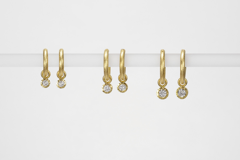 single diamond drops . 18ky gold   small .10 ct tw gh.vs - 530.00   medium .16 ct tw gh.vs - 860.00    large .26 ct tw gh.vs - 1450.00