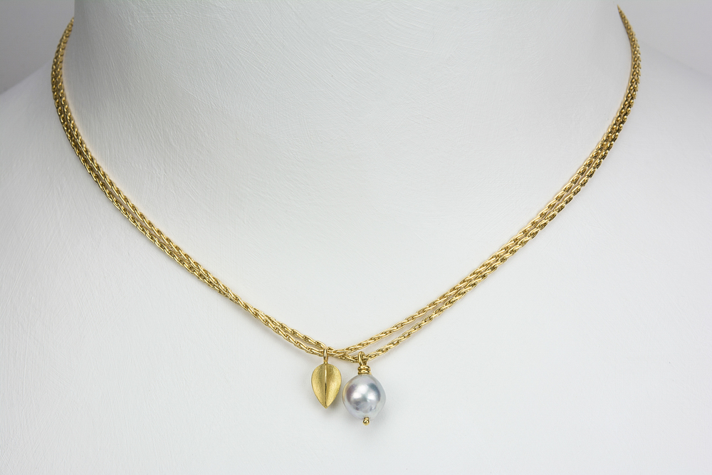 large pod and pearl necklace . 18ky gold 14ky chain Akoyo pearl - 600.00 large pod - 1000.00