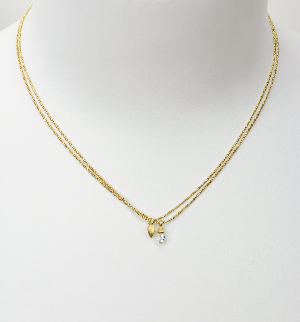 briolette and small pod necklace . 18ky gold 14ky chains .50 ct diamond (sold) others available, price varies with size and quality - pod necklace - 900.00