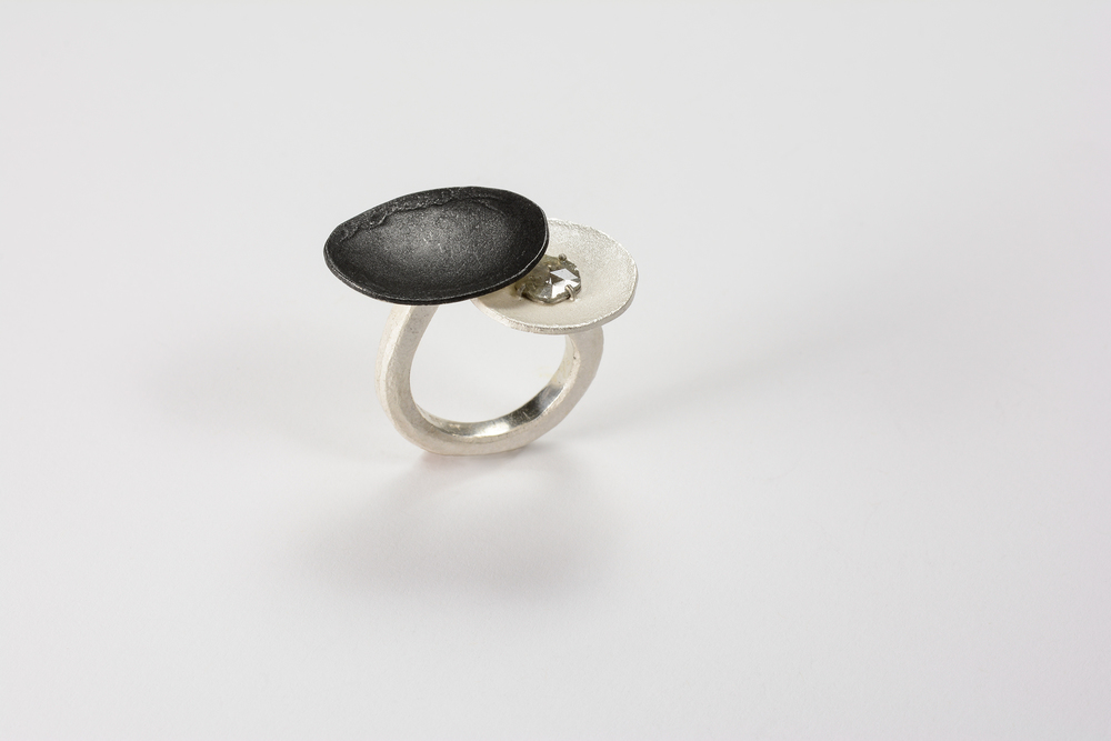 puddle ring . sterling, oxidized sterling and pt .47 ct diamond slice - 2000.00 (sold) another can be made