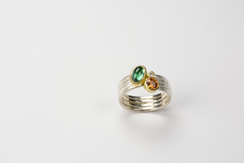 forged band . 18ky gold sterling silver with .95 ct tourmaline, .43 spessartite garnet and .02 ct diamond - 1400.00