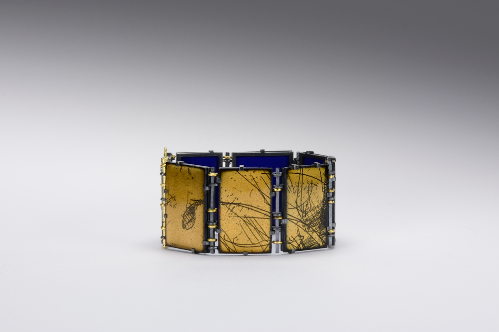 enamel bracelet closed . oxidized sterling and 18ky gold