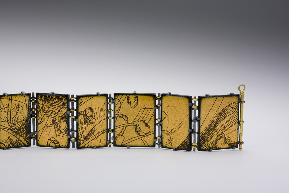 enamel bracelet partial view . oxidized sterling and 18ky gold