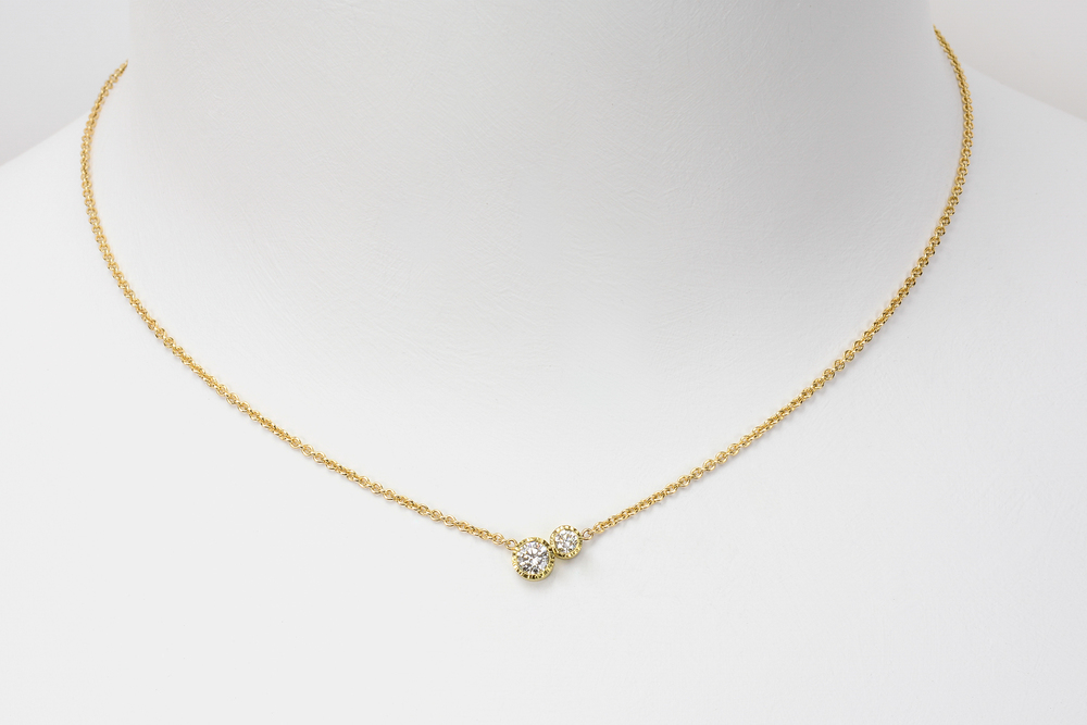large double diamond . 18ky gold 14ky chain approx .45 ct tw gh.vs diamonds - 3600.00