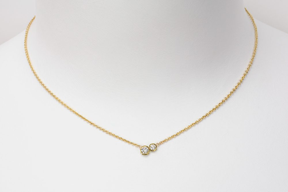 medium double diamond . 18ky gold 14ky chain approx .25 ct tw gh.vs diamonds - 2400.00