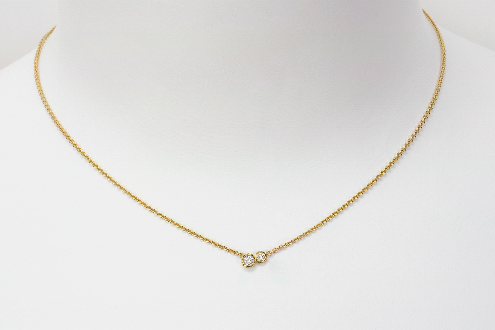 small double diamond . 18ky gold 14ky chain approx .15 ct tw gh.vs diamonds - 1800.00