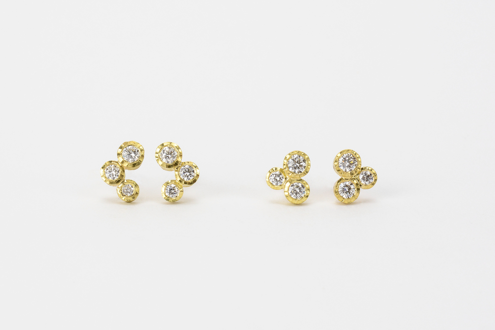 18ky gold with 14k posts and nuts . triple studs .22 ct tw gh.vs - 1140.00 cluster studs .30 ct tw gh.vs - 1400.00