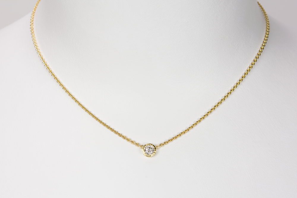 single diamond . 18ky gold 14ky chain : price varies with size and quality of diamond - 3800.00