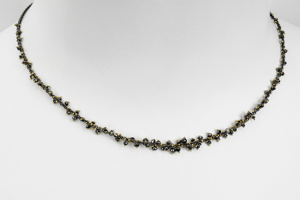 black diamond bead necklace - faceted black diamond beads attached with 18ky gold on an oxidized sterling silver chain - approx 7 ct tw - 2400.00
