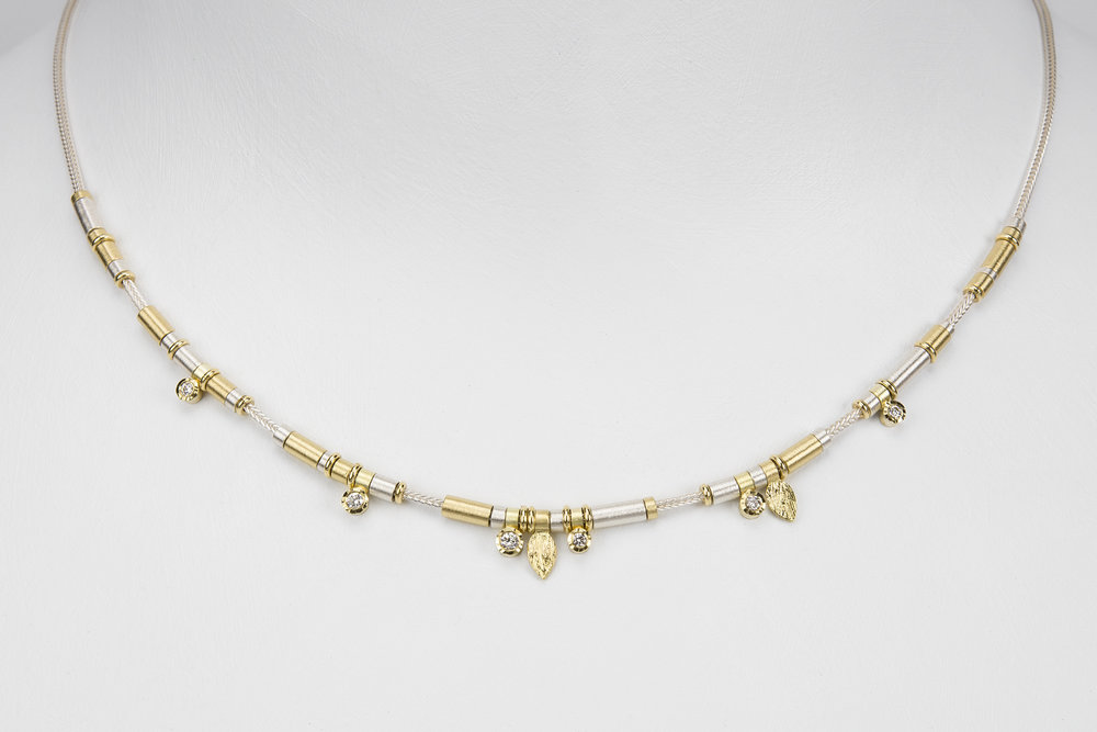 6 diamond drop necklace - sterling silver and 18ky gold with .16 ct tw gh/vs diamonds - 2100.00