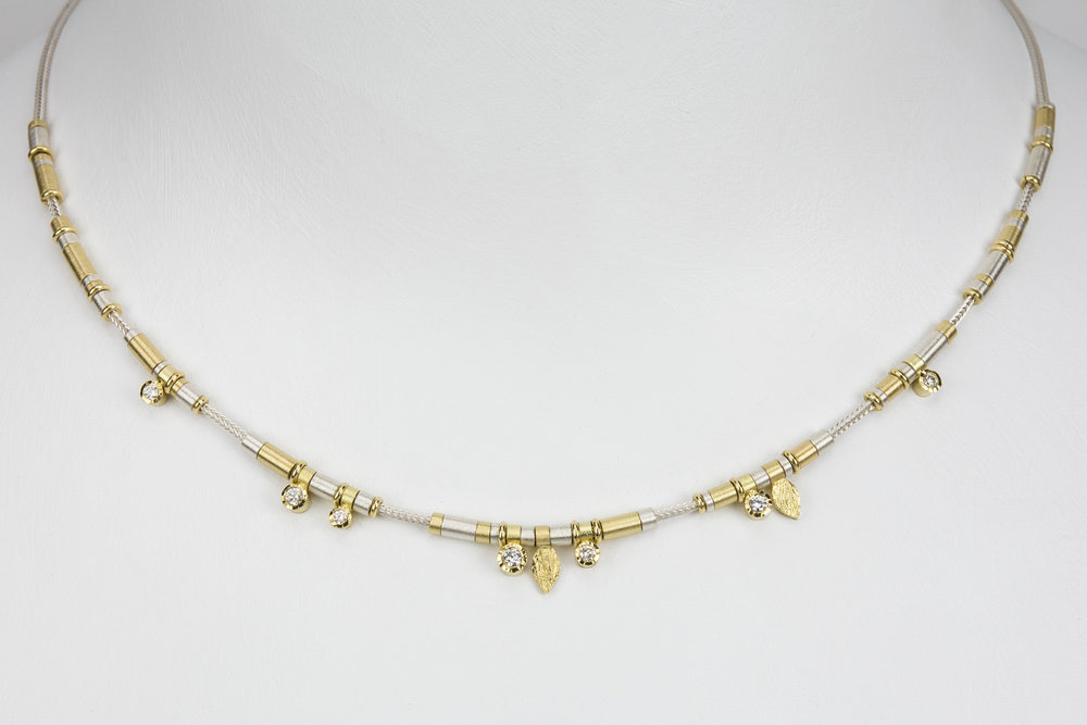 7 diamond drop necklace - sterling silver and 18ky gold with .25 ct tw gh/vs diamonds - 2720.00