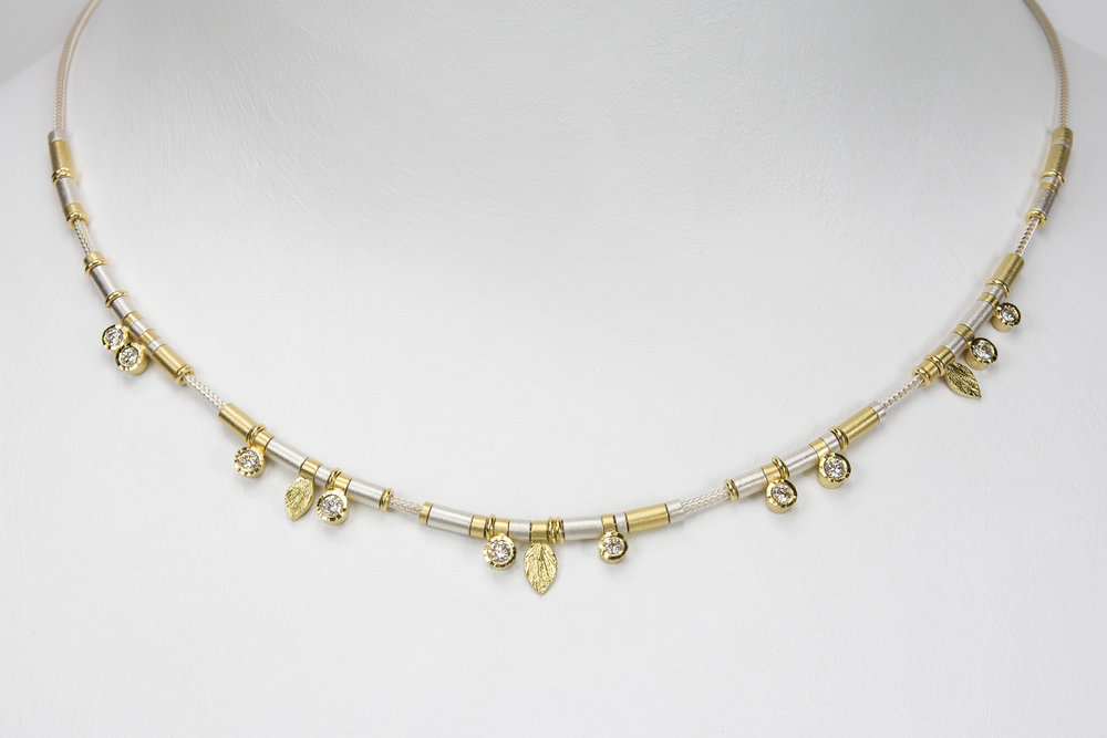 10 diamond drop necklace - sterling silver and 18ky gold with .50 ct tw gh/vs diamonds - 3950.00