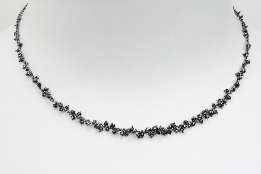 black diamond bead necklace - faceted black diamond beads attached with sterling on an oxidized sterling silver chain - approx 7 ct tw - 2200.00