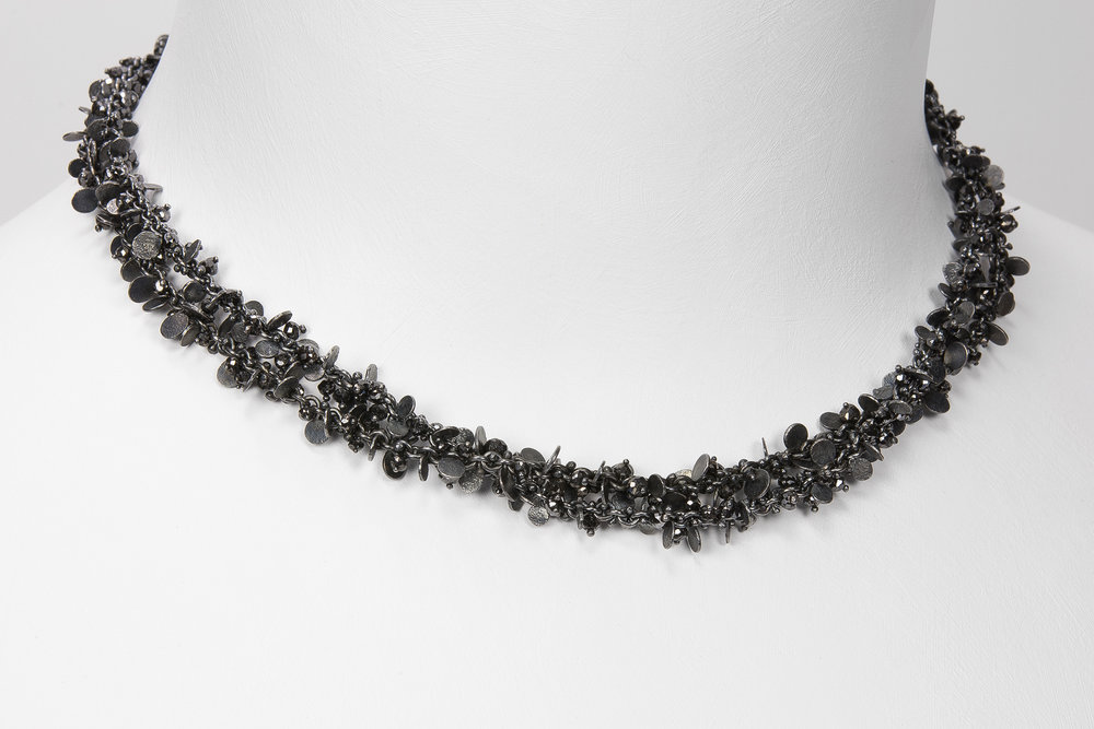 2 oxidized beads and flats necklaces shown together