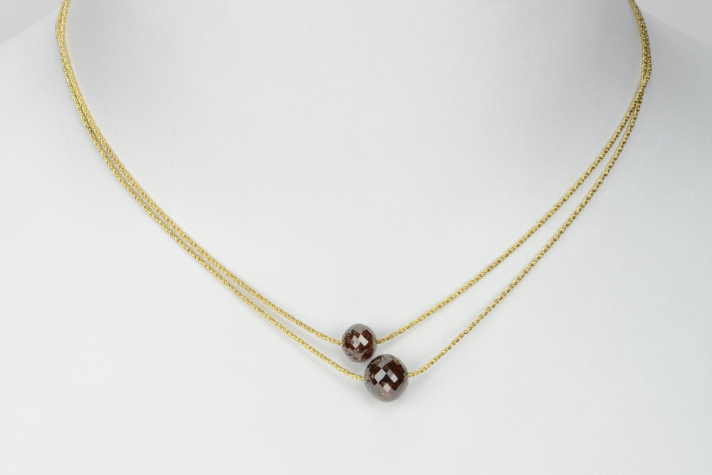 2 single diamond bead necklaces . 14ky . small bead 3.38 - 1350.00 large bead 5.9 ct - 1920.00