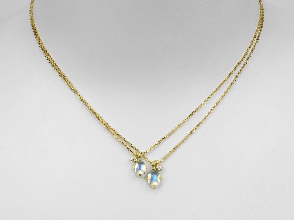 blue moonstones on gold chain with diamonds
