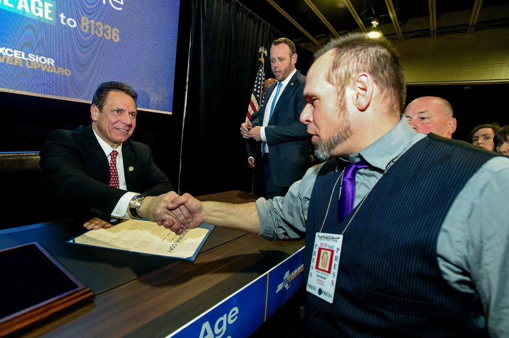 "On assignment, Gov. Cuomo signing ""Raise the Age,"" 2016. Photo by Kevin Coughlin."