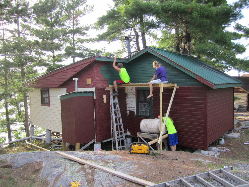 The crew working on painting cabin 3