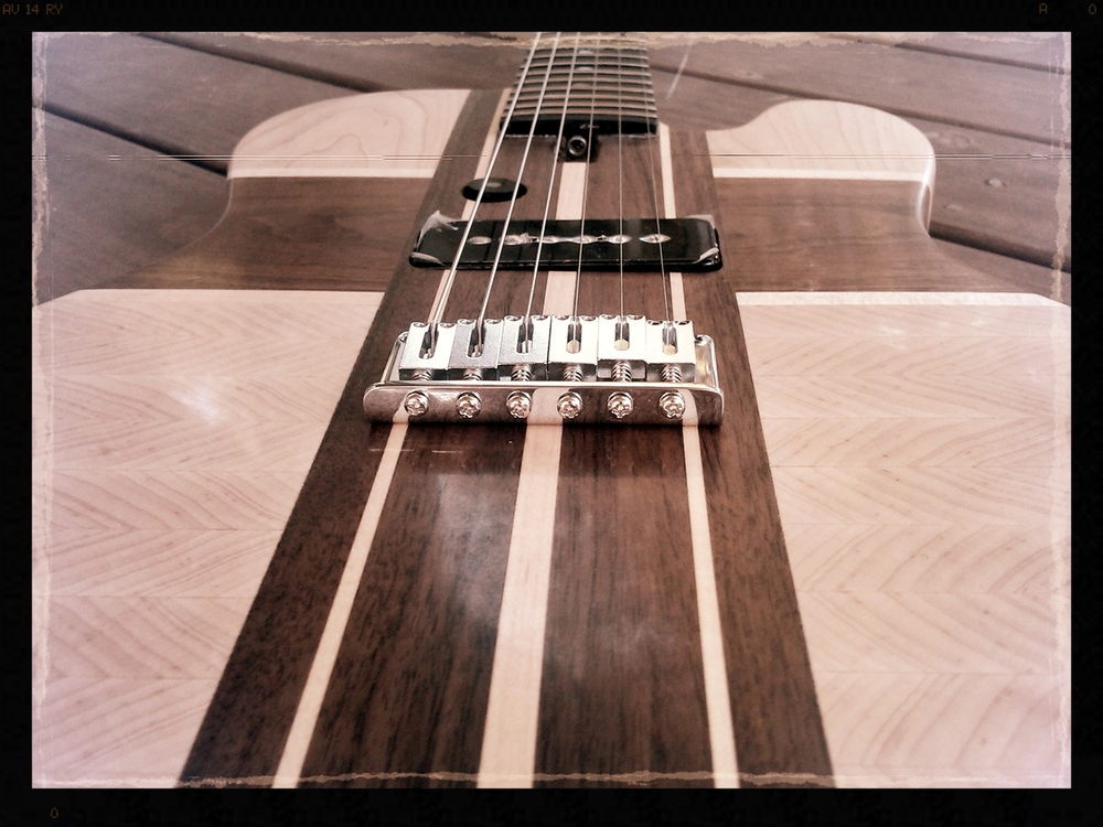 Detail shot of the bridge, pickups, and lower neck.  All she needs now is some trim plates and to be wired up.