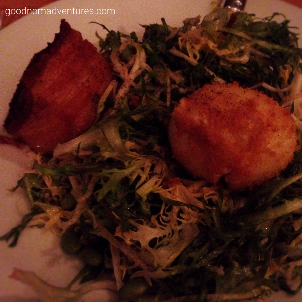 Frisee salad with pork belly and a fried poached egg