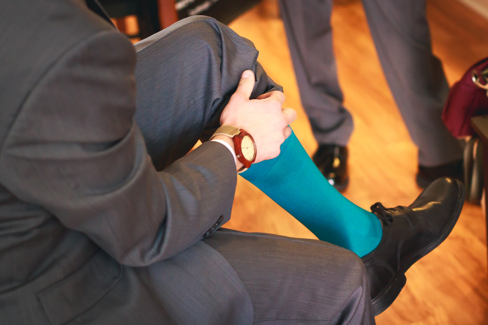 The groom's outfit would not have been complete with out the awesome teal socks.