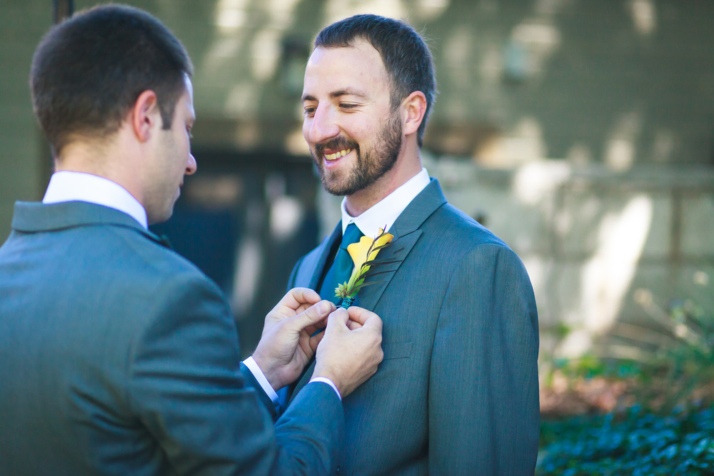 The groom's Best Man and brother pinned on the boutonniere.