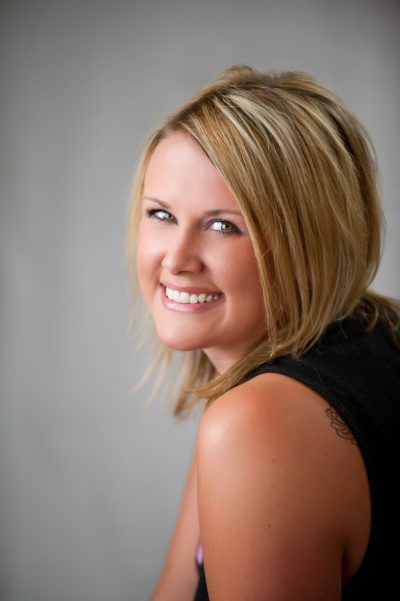 "Tegan Corlies - Wedding Hair Stylist - Tegan has been doing hair for 18 years, 7 of those with Hair Fusion. One of her favorite things to do is formal hair styles for weddings and special occasions. She also specializes in color and fine textured hair in the salon. She is the Wedding Coordinator for Hair Fusion and her best advice for brides is to ""do a trial, it takes the stress and guesswork out of the day of vision for your perfect look. It also allows us to make sure all accessories work well with your chosen style and let's the bride rest easy knowing her dream look can become a reality. Also bring pictures of several looks you like, it greatly improves communication, and we can create your perfect version for your special day"""
