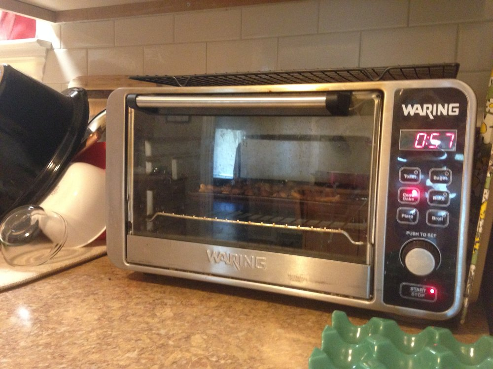 When Temps Rise, Our Thermostat Does Too: Using the toaster oven instead of the large oven to save energy and heat!