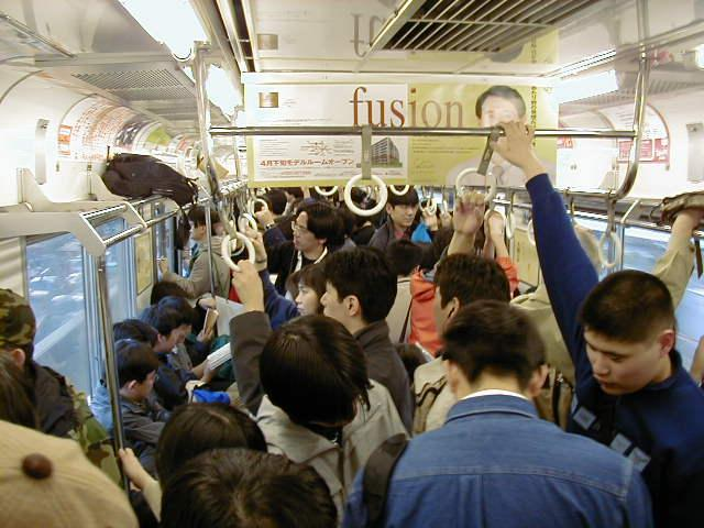 Typical inside of a Japanese subway train. Obviously during a busy time. Compared to the true rush hour, however, this isn't so bad. Being able to get a free seat is the best feeling when you're tired or coming home from a long day and such.