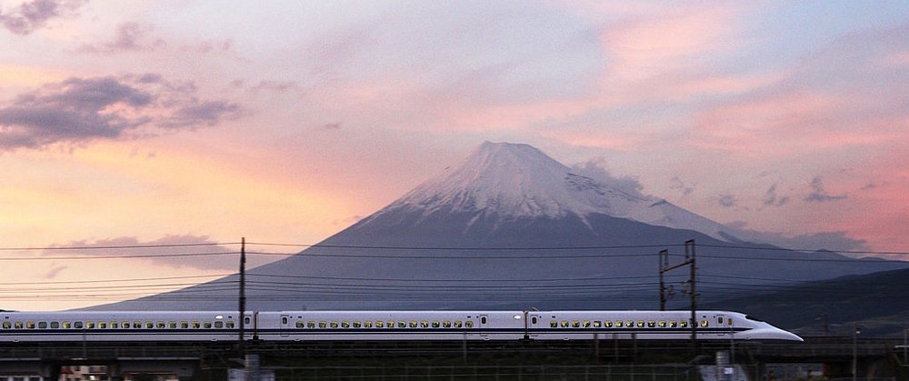 A shinkansen train passes by Mount Fuji in Shizuoka Prefecture.