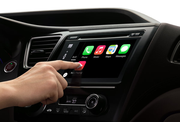 Apple's CarPlay system uses an iPhone to power a car's center screen. Google has a rival system. Roughly two dozen car brands have signed on with each system; many cars will offer both.