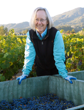 Guest of Honor Cathy Corison pictured in Napa with what are surely some delicious Cabernet grapes!