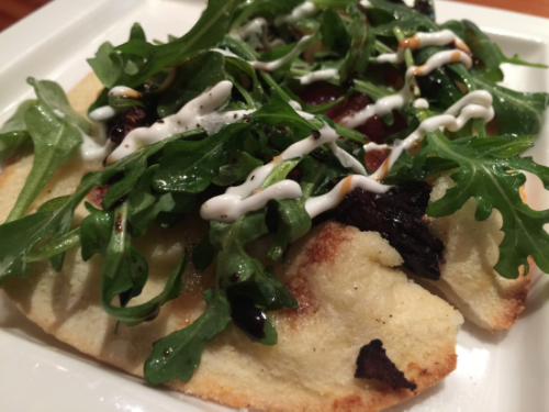 Tarte flambee of fromage blanc, figs, lardons, caramelized onions, arugula, currant gastrique and creme fraiche, paired with the 2012 Corazon Gewurztraminer.