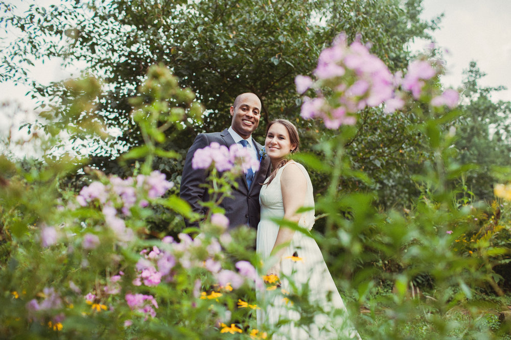 Bride and Groom in flowers.jpg
