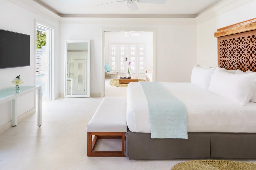 CouplesResorts-OasisSpaSignatureVilla-Bedroom-58d181b4908e5.jpg