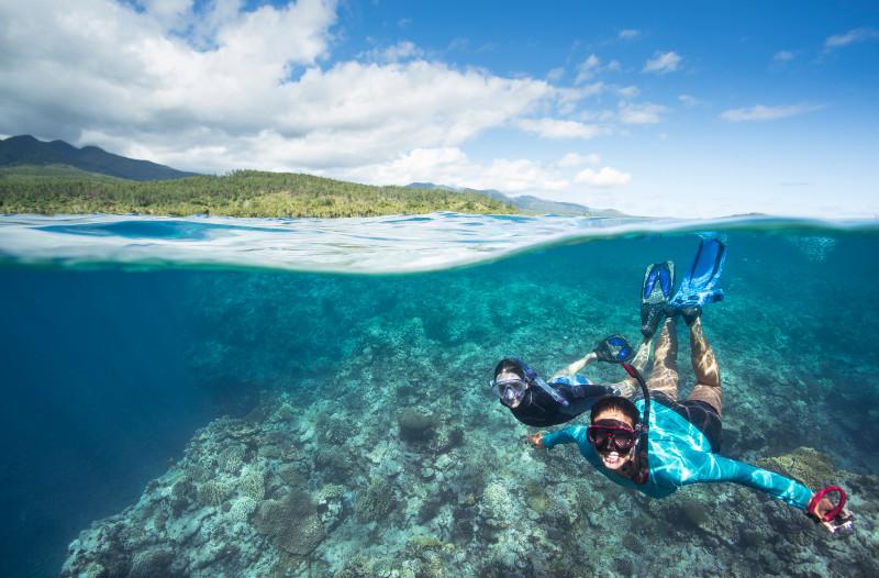 SBN_ASP_RSAY18_Ventures_Underwater reef landscape and snorkellers_near Mystery Island_Vanuatu_8.jpg