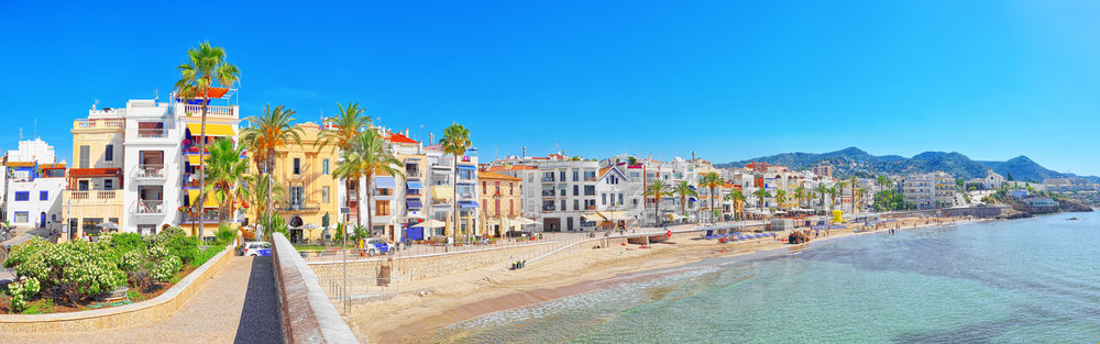 View of the beach and the sea shore of a small resort town Sitges, Spain